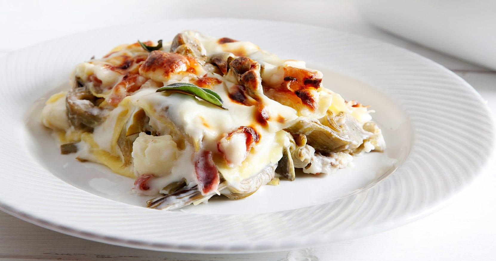 [Video] Lasagne ai carciofi, taleggio e pancetta arrotolata